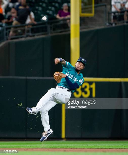 P Crawford of the Seattle Mariners makes a quickturn throw to first base to throw out Jeimer Candelario of the Detroit Tigers to end the top of the...
