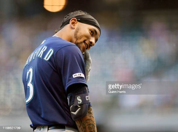 P Crawford of the Seattle Mariners reacts towards his dugout after hitting a RBI triple in the second inning against the Milwaukee Brewers at Miller...