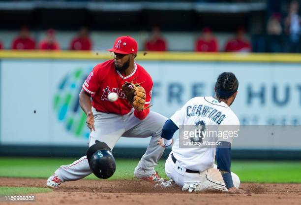 P Crawford of the Seattle Mariners safely steals second base beating the throw to Luis Rengifo of the Los Angeles Angels of Anaheim in the third...