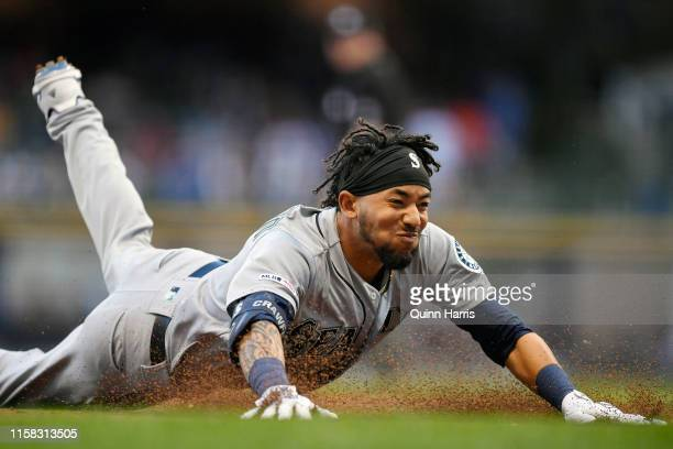 P Crawford of the Seattle Mariners slides for a triple in the third inning against the Milwaukee Brewers at Miller Park on June 25 2019 in Milwaukee...