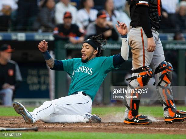 P Crawford of the Seattle Mariners slides home to score in the third inning against the Baltimore Orioles at TMobile Park on June 21 2019 in Seattle...