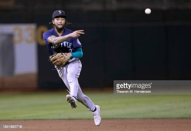 Crawford of the Seattle Mariners throws to first base throwing out Elvis Andrus of the Oakland Athletics in the bottom of the fifth inning at...