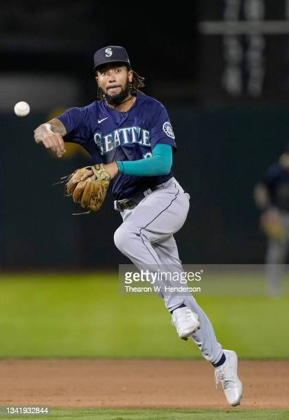 Crawford of the Seattle Mariners throws to first base throwing out Seth Brown of the Oakland Athletics in the bottom of the seventh inning at...