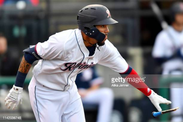 P Crawford of the Tacoma Rainiers drops his broken bat against the El Paso Chihuahuas on opening day at Cheney Stadium on April 09 2019 in Tacoma...
