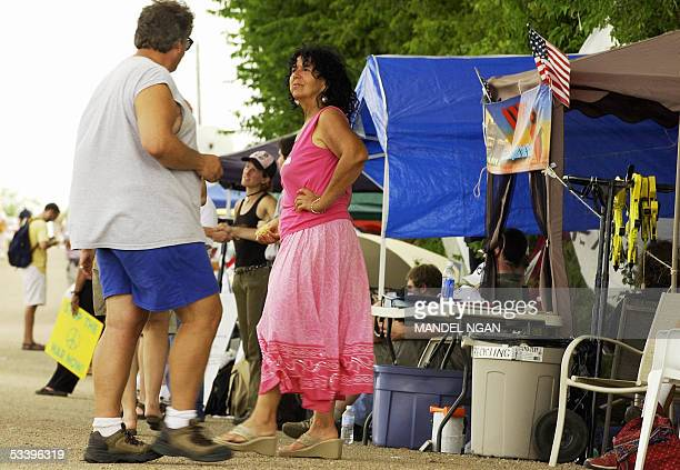 Diane Wilson of Seadrift TX and Bill Donahue of Petlauma CA chat at the makeshift camp of Iraq war protestor Cindy Sheehan 16 August 2005 near the...