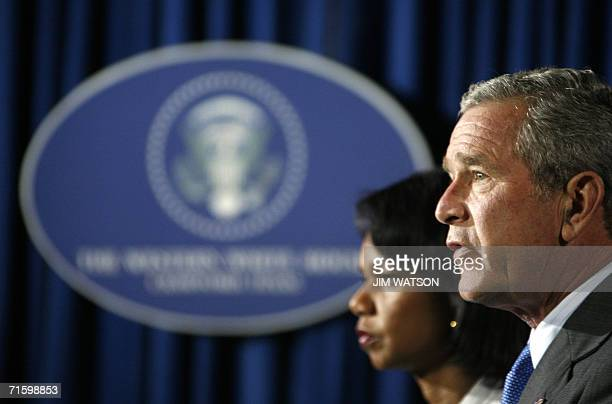 US President George W Bush speaks as US Secretary of State Condoleezza Rice looks on during a press conference from the Bush ranch in Crawford Texas...