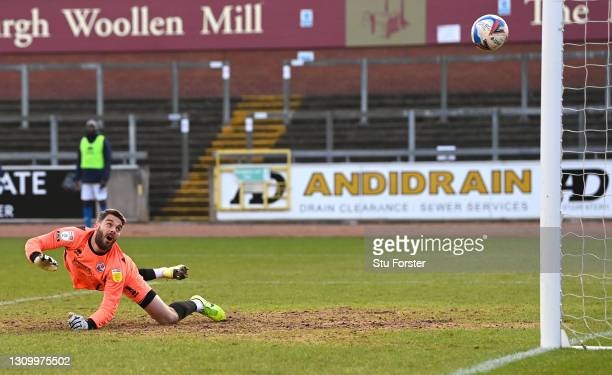 Crawley goalkeeper Glenn Morris is beaten by a shot from Joe Riley for the opening goal during the Sky Bet League Two match between Carlisle United...