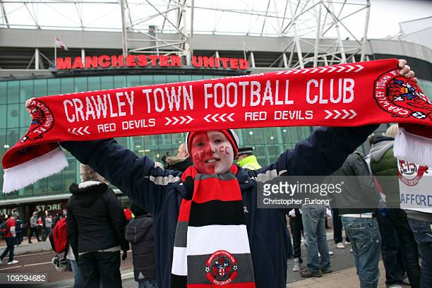 Crawley Town fan Reece Bateman aged 10 enjoys the atmosphere outside Old Trafford as their team prepare to take on Manchester United in the FA Cup...