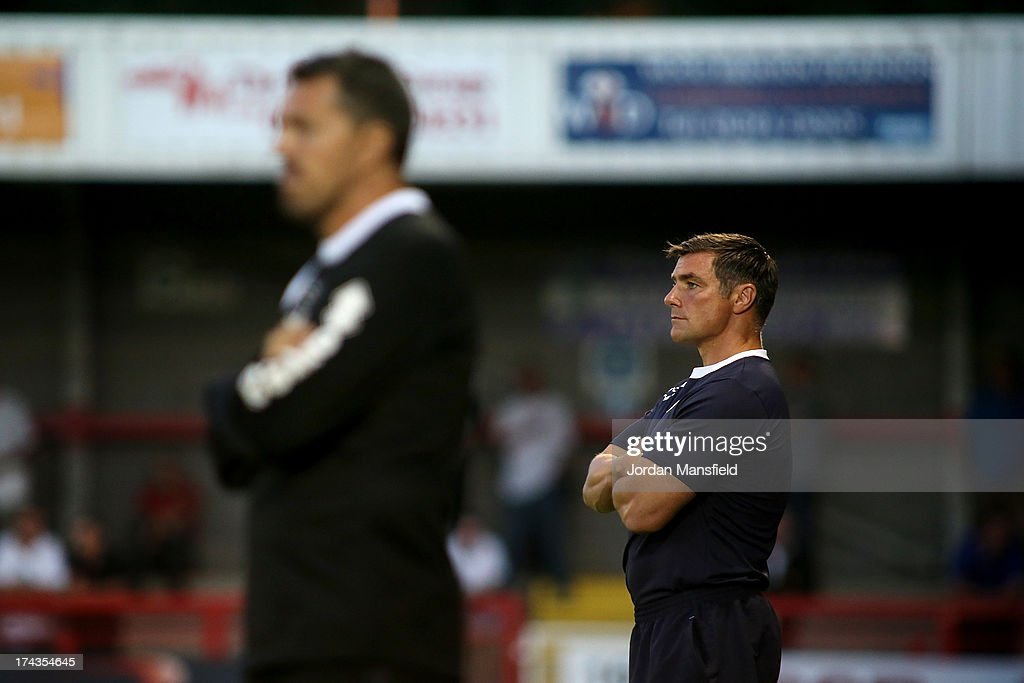 Crawley Town FC manager Richie Barker (R) watches on behind Oscar Garcia during the pre-season friendly between Crawley Town FC and Brighton & Hove Albion at Broadfield Stadium on July 24, 2013 in Crawley, West Sussex.