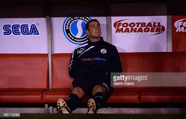 Crawley Town manager Richie Barker sits in the dug out ahead of the Sky Bet League One match between Sheffield United and Crawley Town at Bramall...