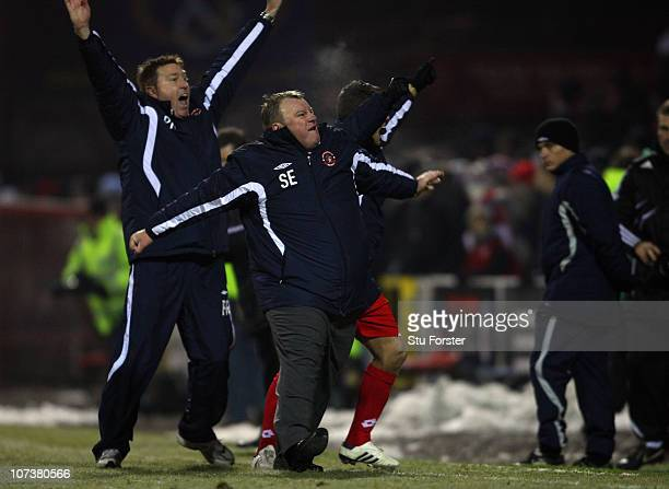 Crawley Town manager Steve Edwards celebrates on the final whistle after the FA Cup 2nd Round Replay between Swindon Town and Crawley Town at City...