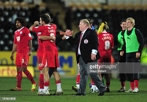 Crawley Town manager Steve Evans congratulates his players at the end of the FA Cup with Budweiser Fourth Round match between Hull City and Crawley...
