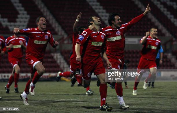 Crawley Town player Ben Smith celebrates with team mates after scoring the winning goal during the FA Cup 2nd Round Replay between Swindon Town and...