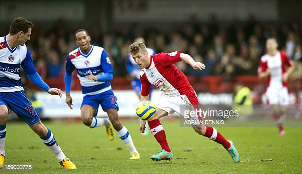 Crawley Town's Billy Clarke vies for the ball against Reading's English defender Sean Morrison during the English FA Cup third round football match...
