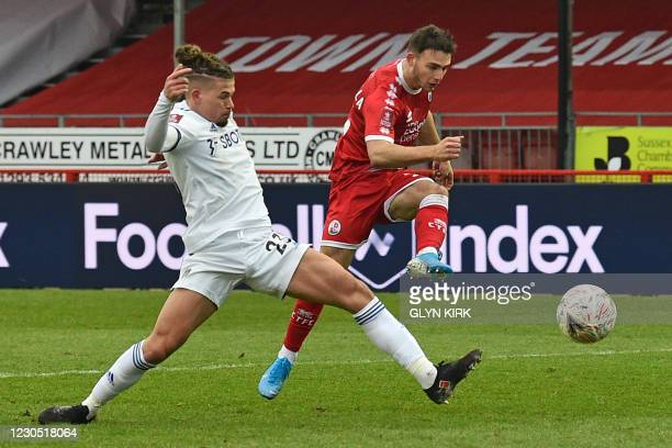 Crawley Town's Cypriot defender Nick Tsaroulla shoots past Leeds United's English midfielder Kalvin Phillips to open the scoring during the English...