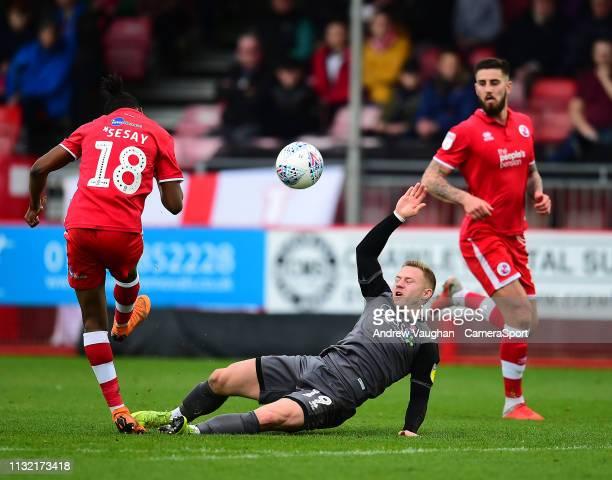 Crawley Town's David Sesay clears under pressure from Lincoln City's Danny Rowe during the Sky Bet League Two match between Crawley Town and Lincoln...
