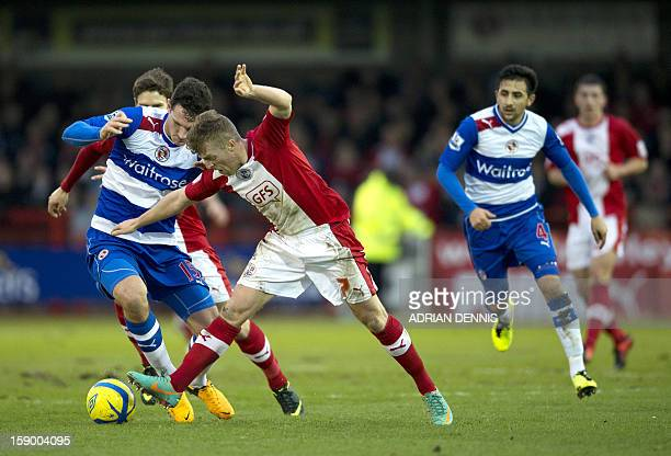 Crawley Town's Irish striker Billy Clarke vies for the ball against Reading's English defender Sean Morrison during the English FA Cup third round...