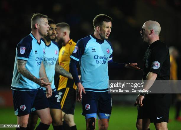 Crawley Town's Jimmy Smith protests with Referee Simon Hooper after a penalty is given against his side during the Sky Bet League Two match between...
