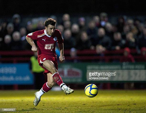 Crawley Town's Matt Tubbs shoots to score the opening goal against Bristol City during the FA Cup third round football match at Broadfield Stadium in...