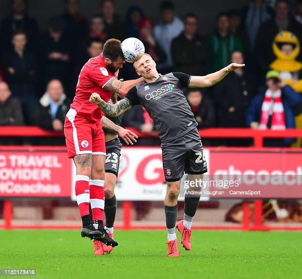 Crawley Town's Ollie Palmer vies for possession with Lincoln City's Harry Anderson during the Sky Bet League Two match between Crawley Town and...