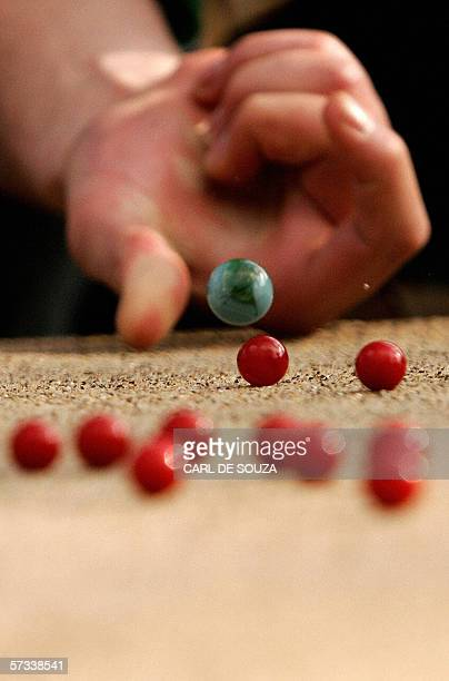 A competitor plays marbles during the annual World Marbles Championships in Crawley West Sussex 14 April 2006 The traditional British game and hobby...