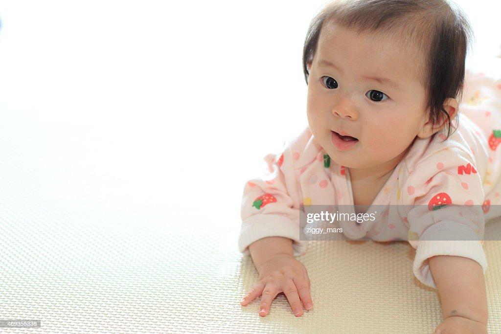 Crawling baby girl : Stock Photo