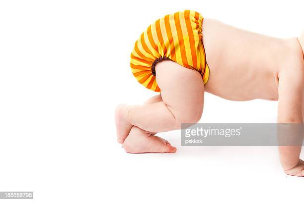 Crawling baby lifting cloth diaper high up
