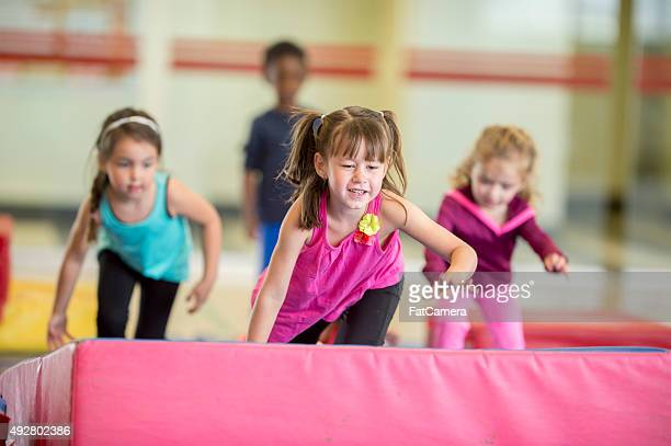 crawling over gymnastics mats - gymnastics stock pictures, royalty-free photos & images