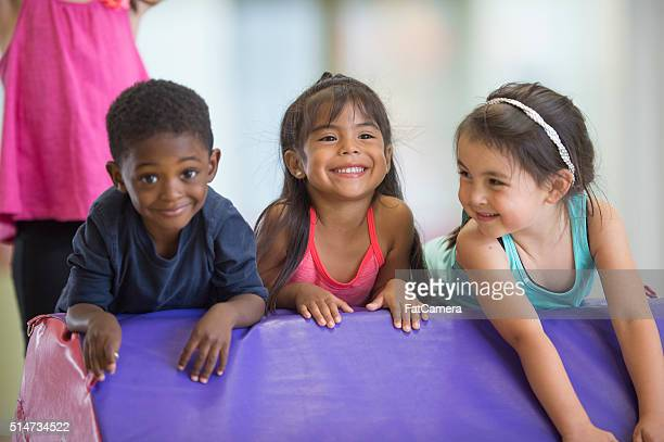crawling up a mat in gymnastics - gymnastics stock pictures, royalty-free photos & images