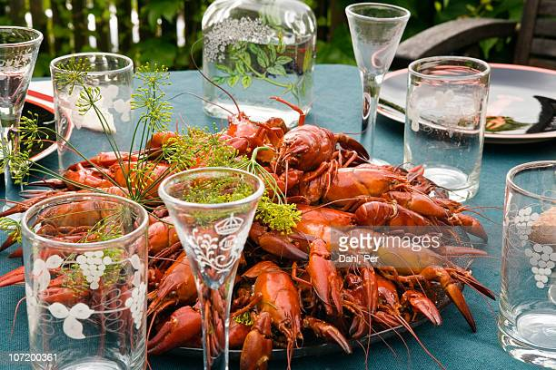 Crayfish on table with crockery