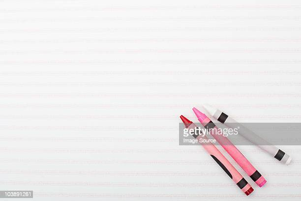 Crayons on line background