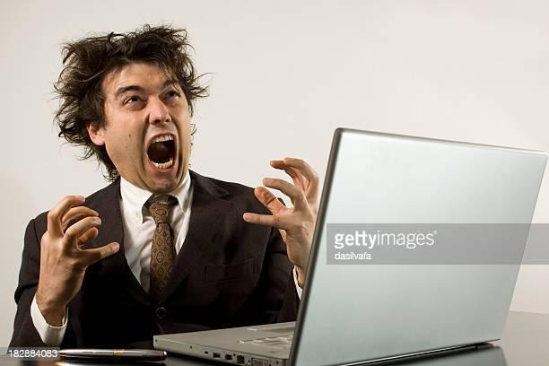 crazy businessman frustrated with his computer - frustratie stockfoto's en -beelden