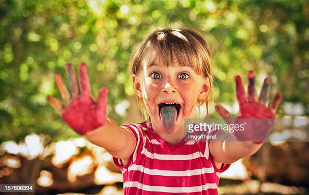 crazy color kid - little girl sticking out tongue stock photos and pictures
