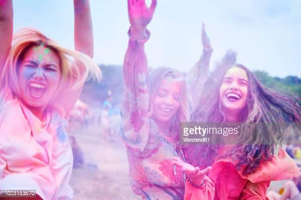 Crazy friends having fun with holi powder