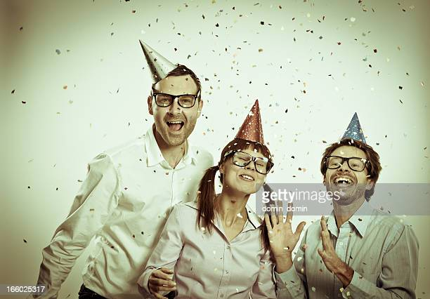 crazy geek people toothy smiling, party hats, confetti, retro look - thick rimmed spectacles stock photos and pictures