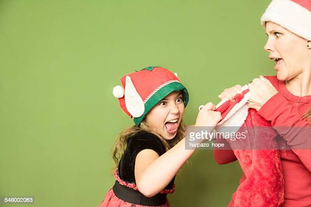 Crazy girl grabbing a Christmas stocking.
