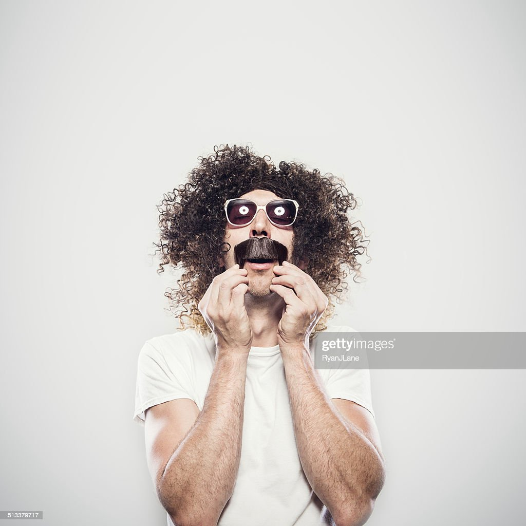 Crazy Hair and Mustache Guy : Stock Photo