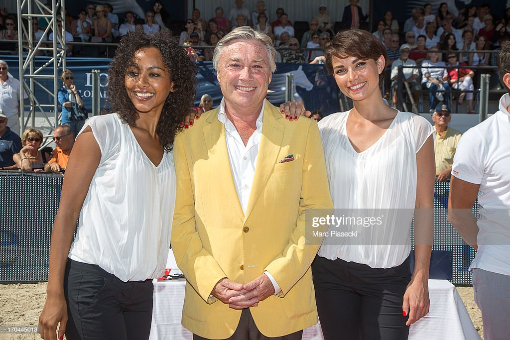 'Crazy Horse Saloon' dancers Yaffa Yemella and Enny Gmatic pose with Francois Bourey, President of the International Jumping of Cannes, during the 'Longines Global Champions Tour of Cannes 2013' on June 13, 2013 in Cannes, France.