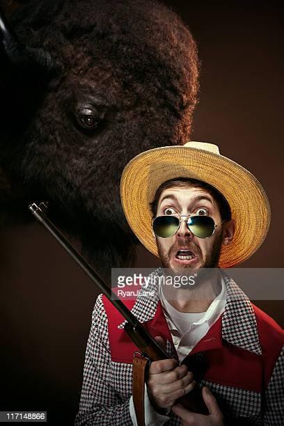 Crazy Hunter Guy With Buffalo and Gun