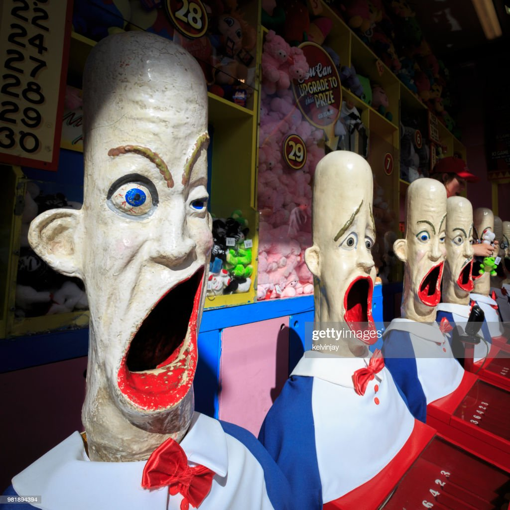 Crazy looking heads in amusement park game booth, Luna Park, Sydney, Australia : Stock Photo