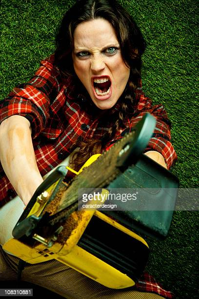 crazy lumberjack holding a chainsaw