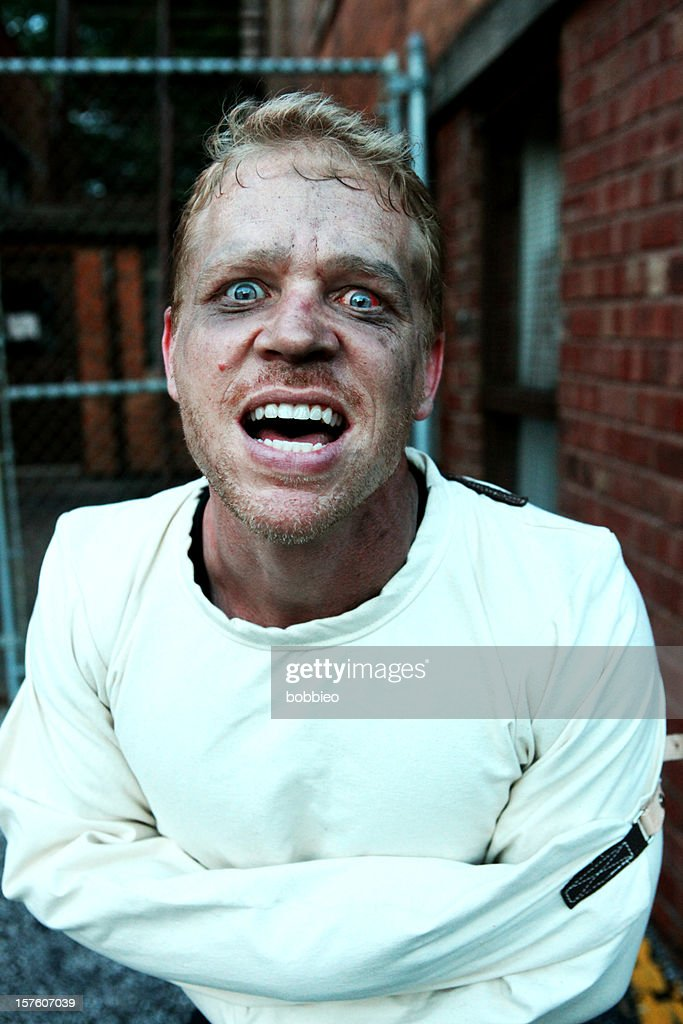 crazy man in straight jacket stock photo getty images