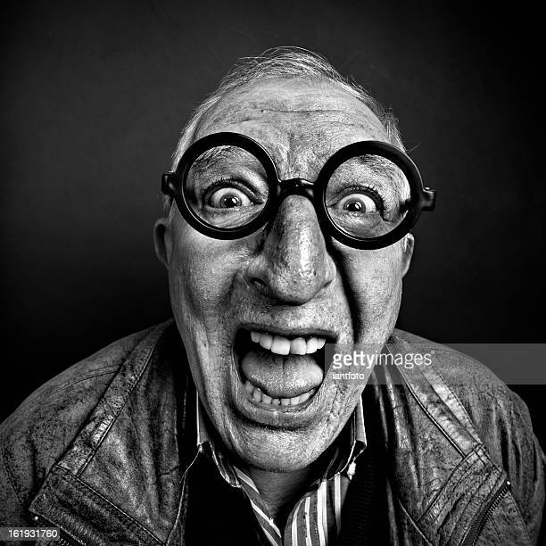 crazy man with glasses. - ugly black men stock photos and pictures