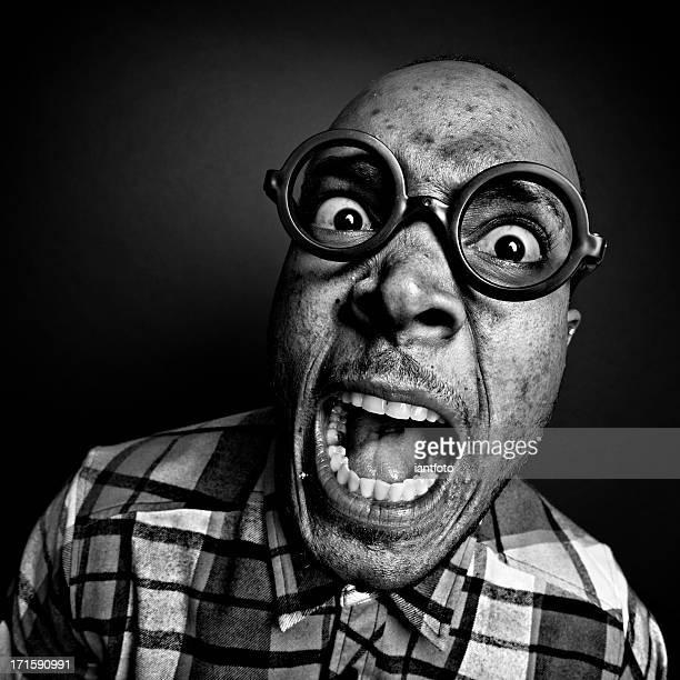 crazy man with glasses. - ugly face stock photos and pictures