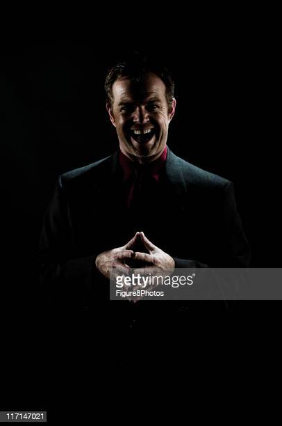 crazy man with laugh - evil stock photos and pictures