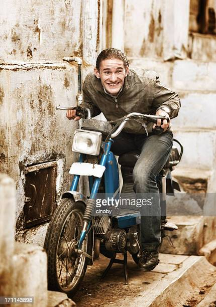crazy moped rider - moped stock photos and pictures