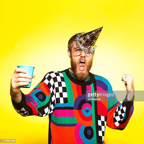 crazy new years party guy - yellow hat stock pictures, royalty-free photos & images