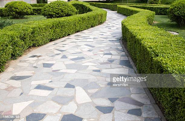 crazy paving path winding between hedges in a beijing park - paving stone stock pictures, royalty-free photos & images