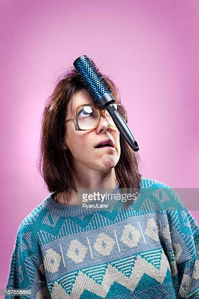 crazy pink 1980s girl and sweater - girl nerd hairstyles stock photos and pictures