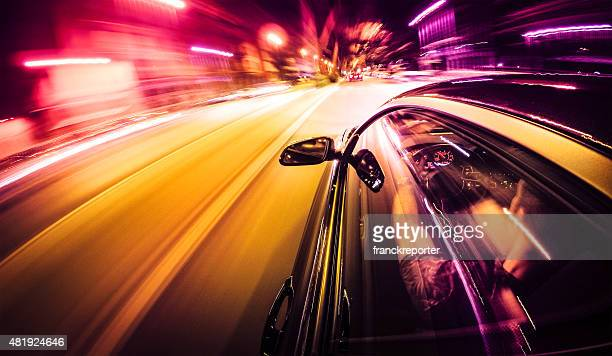 crazy ride on the night by car - muscle car stock photos and pictures
